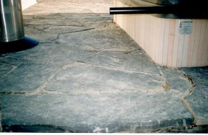 Rundle Stone Slab Patio wrapping around hot tub