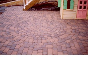 Multi-Color A/B Brick Pavers Circular Patio Design for a clean kids play area