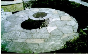 Plenty of room for chairs around a cozy BBQ fire in this Rundle Stone Circular Patio