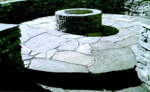 Sit inside or on top of the Stacked Rundle Stone Retaining Wall & Rundle Stone Slab Patio
